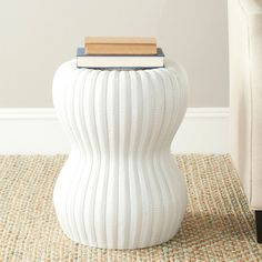Upgrade your garden, and create a spot to sit and admire your flowers by adding this Safavieh Paradise white ceramic garden stool. This 18-inch tall, shiny ceramic stool can also be used as a side table or plant stand both indoors and outdoors.