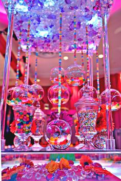 Candy Centerpieces are a hot trend right now in bar & bat mitzvah decor, sweet 16 parties, and even some whimsical weddings. Here are 6 ideas for showcasing your Candy Centerpieces, including ideas for showcasing your colors, themes or initials. Sweet 16 Birthday, Birthday Parties, Candy Centerpieces, Centerpiece Ideas, Quince Centerpieces, Quince Decorations, Candy Decorations, Candy Land Theme, Bar A Bonbon