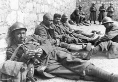 campaign in the west (battle of France) -: French soldiers taken prisoners resting near to a wall. no further informationabout