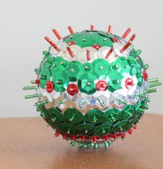 Like a disco ball for your Christmas tree, this Brightly Beaded Ball Ornament has everything you want in your DIY Christmas ornaments. You use a Styrofoam ball as the ball base and then cover it in red, green, and silver bugle and seed beads. Christmas Angel Crafts, Beaded Christmas Ornaments, Ball Ornaments, Christmas Balls, Handmade Christmas, Holiday Crafts, Christmas Crafts, Christmas Patterns, Christmas 2017