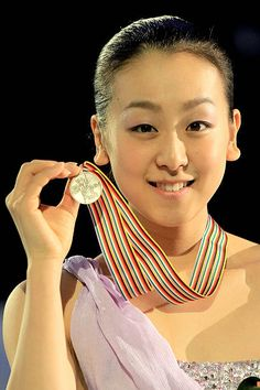 Mao Asada of Japan poses for photographers after the Ladies Competition during the ISU Four Continents Figure Skating Championships at World Arena on February 11, 2012 in Colorado Springs, Colorado.