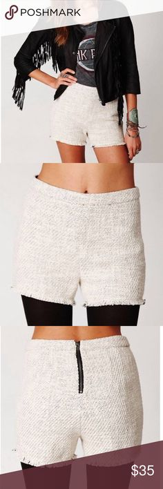 Free People tweed raw hem shorts Free People textured tweed raw hem shorts, cream/black, great condition with no flaws, zips up in back, high waisted, interior is lined, size 0. Bundle to save 10% off ❤️ Free People Shorts