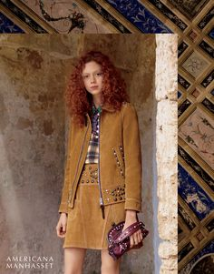 Natalie Westling poses in Coach jacket, top, skirt and bag in Americana…