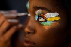 Rio de Janeiro, Brazil: a stylist applies makeup to a model at Fashion Rio Photograph: Victor R. Caivano/AP