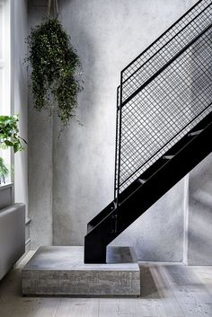 Industrial staircase in minimalist loft via La Maison d'Anna. Join and get your exclusive subscription of elevated essentials for design enthusiasts @ minimalism.co