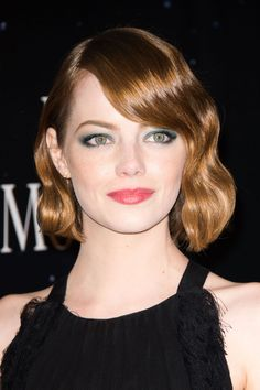 Emma Stone's green eyes surrounded by green eyeshadow all against the backdrop of her red hair? Heaven. Behold the gorgeousness of the whole look she wore at the Magic in the Moonlight Paris premiere. I know not everyone is a fan of matching your eyeshadow to your eye color, but I think it works on Stone here for two reasons: 1) She's Emma Stone. 2) The two colors are different enough for her eyes (which are soft green) not to completely blend in with the shadow (which is richer turquoise)…
