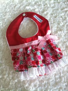 This baby girl bib is perfect for your precious little one to wear on Christmas. It is backed with super soft and cuddly white minky fabric.