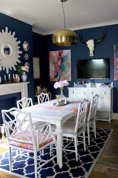 Swoon Worthy - dark blue dining room with white furniture and bright accents