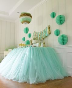 Table Decorated with Tulle (inspiration only : pink for girls birthday party, mint green for baby shower, white for wedding table - ideas are endless). Loving the tassel garland!!