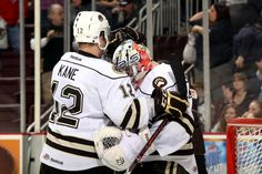 2.23.13 - Captain Boyd Kane congratulating Philipp Grubauer on his first AHL Shutout.  Photo courtesy of JustSports Photography