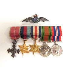 A WW2 MBE group of five miniature British dress medals.. A WW2 MBE group of five miniature British dress medals. Consisting of an MBE military medal, the 1939 - 1945 Star, the France and Germany Star, the 1939 - 45 War medal and a Defence medal together with a sterling silver enamelled RAF badge. (6 items) Badge: 1.8 in (4.5 cm) width.