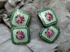 This is an utterly charming pair of sterling silver and guilloche enamel double button style cuff links with hand painted roses at the center of