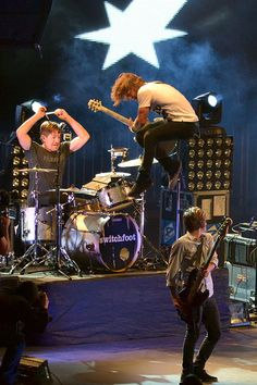 Such a great shot. And look how high Jon is! It's like he jumped over Tim.