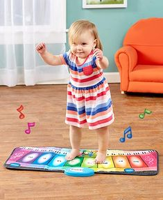 Kids can make music by dancing around on this Rainbow Piano Mat. It's a soft, safe and portable floor piano. It has 8 keys and 8 programmed tunes. Select betwee