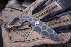 Night Shift, 3 blade, 1 tall, 5 1/2 overall, 1/8 thick 52100 high carbon alloy.   The handle features a hex bit driver/bottle opener and a 6,8,10,12,14mm wrench built in. Finished in two tone gunkote olive over tan in gator pattern, razor sharp and ready for service. A coyote tan kydex sheath like shown is included. The stainless steel sheath tension fastener is recommend for maximum security but can be removed for a lighter draw. This is a great all around blade design suited ...