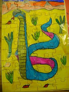 Great gift idea: cobras painted on puzzles by students in Mercer County NJ.