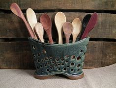 Love this idea!  Good for utensils and dish sponges depending upon its size!