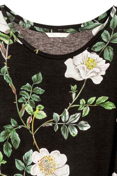 Top in jersey maniche lunghe - Nero/fiori - DONNA | H&M IT
