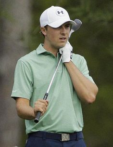 Jordan Spieth clutches his club after his approach shot on the eighth hole during the fourth round of the Masters golf tournament Sunday, Ap...