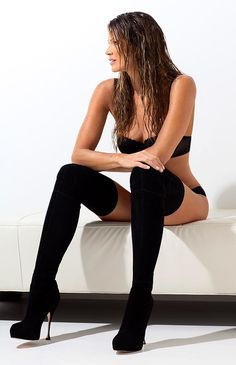 Elle Macpherson in knee high boots