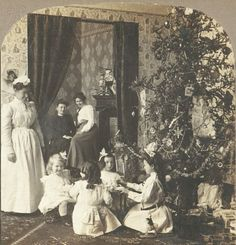 An American Gilded Age era Christmas, c.1900. Little girls having a Christmas tea party in the parlor, aside a decorated Christmas tree and presents. ~ {cwl} ~ (Image: vintag.es)