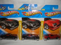 "HOT WHEELS 2012 NEW MODELS EDITION #22 OF 247 SET OF 3 1985 CHEVROLET CAMARO IROC-Z 28, 2 GRAY, 1 RED, GRAY WITH ""HOT WHEELS"" TEMPO ON WINDSHIELD AND ONE NO TEMPO, HOT WHEELS 3 1985 IROC-Z CAMARO DIE-CAST by MATTEL. $14.99. 3 NEW MODEL EDITION CAMARO DIE-CAST. HOT WHEELS TEMPO ON WINDSHIELD EDITION"