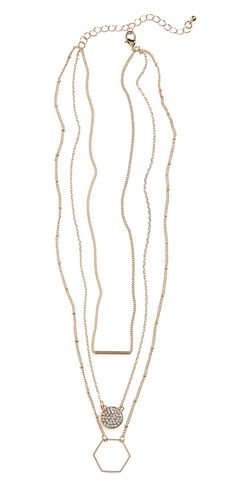 On trend: delicate gold necklaces layered for a chic look.