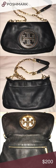 Tory Burch Amanda Leather Logo Clutch Black/Gold Tory Burch Amanda Leather Logo Clutch in great condition! Two zip pockets inside. Magnetic flap over snap closure. No stains on or inside purse! Can wear as a cross body, shoulder bag, or as a clutch with the straps tucked into purse! Tory Burch Bags Crossbody Bags