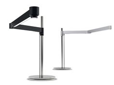 This workplace lamp was designed to meet the sophisticated demands of dental laboratories. Equipped with an adjustable and process-controlled LED-system, this lamp illuminates a workplace with up to 6,000 lux so that natural tooth shades are rendered accurately. In addition, it offers five different lighting scenarios, from daylight to UV-light. The LED sidelights are distributed along the two anodised aluminium shanks of the arm. The arm comes in black and silver, can be pivoted, and is…