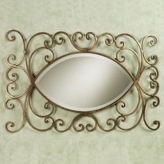 Andreano Wall Mirror.  I like this because it looks like an eye.