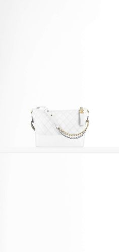 CHANEL'sGABRIELLE hobo bag, aged calfskin, smooth calfskin, silver-tone & gold-tone metal-beige & black - CHANEL