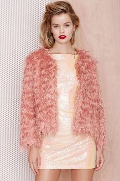 Look sweeter than ever in this pink shag coat.
