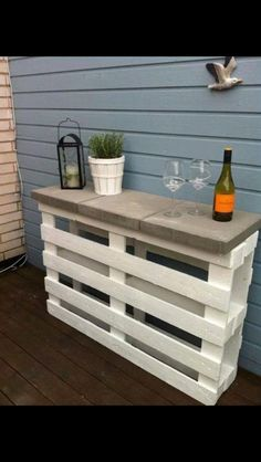 2 pallets and 3 square paving slabs to make outdoor shelving