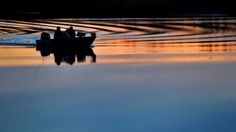 Shannon Thomas and Gino Harris ride a boat through the Warwick River as the sun sets near the Denbigh Park boat ramp Tuesday evening. (Photo by Jonathon Gruenke / Daily Press) The Virginian, Sun Sets, Hampton Roads, The Hamptons, Tuesday, Boat, River, Park