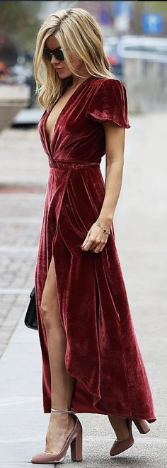 Long red velvet short sleeve dress.