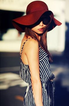 Black & white striped dress with a red hat.