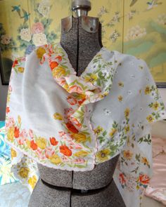 I absolutely love vintage handkerchiefs and have quite a collection of them. They are far too lovely to keep in a drawer. This darling scarf is for the vintage girl. Its the perfect summer accessory and its one-of-a-kind. This one is mainly yellow and orange, with a touch of light blue. There are six hankies zigzag-stitched together (80x12) All materials have been laundered.