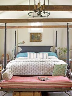 Place a folding iron camp cot at the foot of your bed as a napping spot for your dogs.