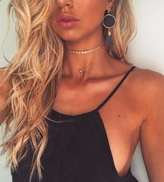 black tank + layered gold necklaces