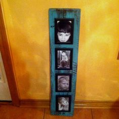 Paint a piece of wood and add some dollar store frames on top. Simple simple simple diy project. Would be cute for displaying kids art