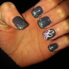 Grey with glitter and design on ring finger
