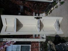 Old door turned into a corner shelf!  www.dumpster-diva-mimi.blogspot.com