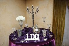 Eggplant linen with crystals, bling, and silver decor Photo by @StepOnMe Photography