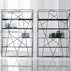 This bookcase features interwoven strands of lacquered metal that support glass shelves. Its bold, classic design is perfect for any space in your home, from living room to study.Bookshelf is made ofinterwoven strands of lacquered metal that support glass shelves Available in your choice of black or white. Delivery within 4-5 weeks.