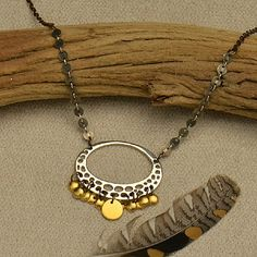 Repeating patterns creates mesmerizing designs. Throw multiple metal finishes into the mix, and you have a unique and playful design. Round shapes are found throughout this design, and the mix of gold, brass, and silver adds a warm and rustic feel. http://www.ninadesigns.com/jewelry_design_ideas/confetti_necklace.html