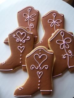 Rodeo decorated sugar cookies. Royal icing. Brown, pink. Cowboy boot. Houston, Texas.