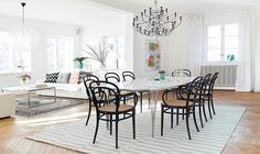 A 20's villa with design classics such as the table Superellips and Thonet chairs in combination withe vases and pots from Svenskt tenn and a marble tray by Hay.