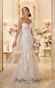 Stella York #6257 - Standout lace appliques on fine tulle work together to create a stunning design from Stella York. You'll love how the strapless sweetheart neckline with lace detailing frames your face, while the fitted bodice hugs your every curve.
