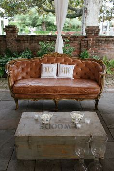 10 Luxe Leather Details - Lounge in style - a plush leather sofa and monogrammed cushions. Source: junebugweddings.com #reception #leather #weddingseating