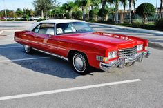 1973 Cadillac Eldorado Convertible 500 CID V-8 Engine,Automatic Transmission,Factory Parade Boot Power Top,Power Windows ,Power Seats ,Under 47,143 Miles, Dynasty Red with white convertible top.